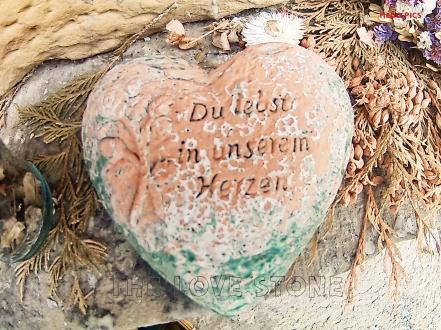 stone written on to show jesus love