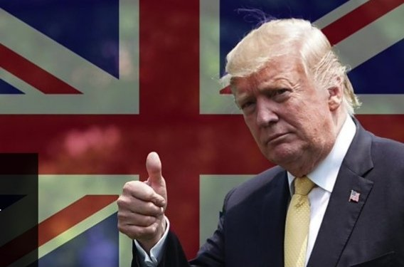 President Trump shows thumbs-up infront of the UK flag during his visit