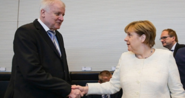 Chancellor Angela Markel shakes the the Germany interior minister, on July 2018