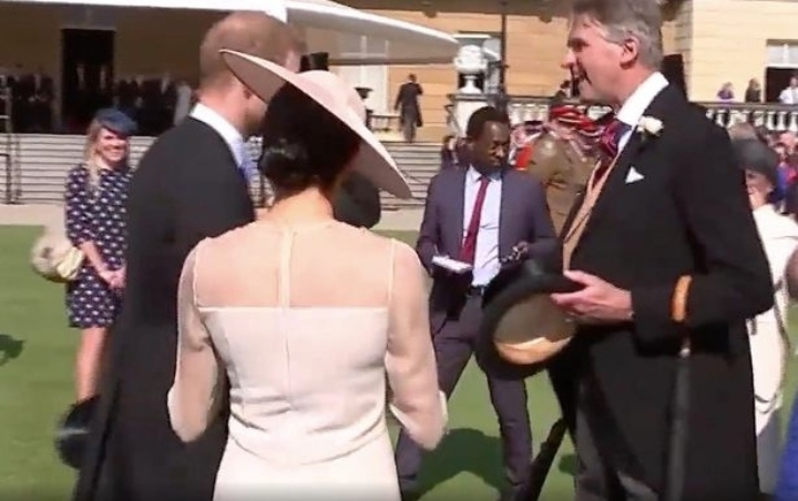 Meghan and Harry were approached by a member of staff, who told them Charles wanted a chat