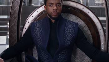 PICTURE OF BLACKPANTHER SITTING ON A CHAIR