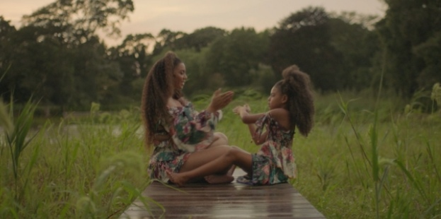 Beyoncé playing with her Daughter Ivy-Blue on the countryside Bridge in the African way